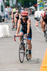 Ivan Popov riding a bicycle at the triathlon in Burgas